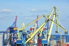 Cargo crane and grain dryer Stock Images