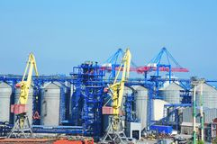 Cargo crane and grain silo Royalty Free Stock Photography