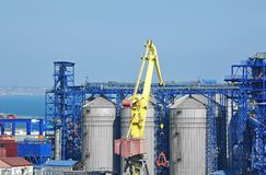 Cargo crane and grain silo Stock Image