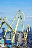 Cargo crane and grain silo. In port Odessa, Ukraine Stock Photos