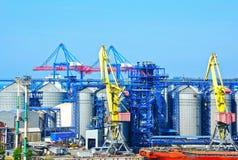 Cargo crane and grain silo. In port Odessa, Ukraine royalty free stock photos