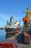 Cargo crane, pipe, train and ship Stock Photo