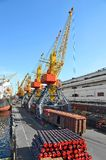 Cargo crane, pipe, train and ship Royalty Free Stock Photography