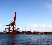 Cargo crane in port. Industrial cargo crane on the shore in industrial port Stock Photo