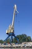Cargo crane in port. Cargo crane is in port against blue sky Stock Images