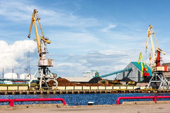 Cargo crane in the port of the Baltic against the blue sky in su Stock Photo