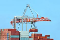 Cargo crane and ship stock images