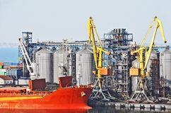 Cargo crane, ship and grain dryer Royalty Free Stock Images