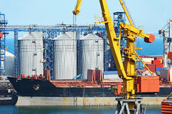 Cargo crane, ship and grain dryer Royalty Free Stock Photo