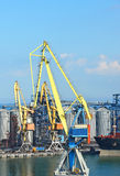 Cargo crane, ship and grain dryer Royalty Free Stock Photography
