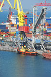 Cargo crane and tugboat Royalty Free Stock Photography