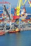 Cargo crane and tugboat Stock Image