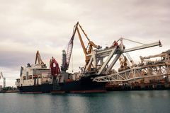 Cargo cranes in the dock Royalty Free Stock Images