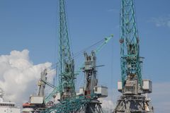 Cargo Cranes in Industrial Port. Sea port, cargo crane expects the ship for loading. Cranes in the harbour stock photography