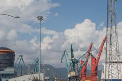 Cargo Cranes in Industrial Port. Sea port, cargo crane expects the ship for loading. Cranes in the harbour stock photos