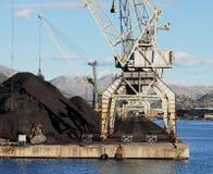 Cargo cranes loading iron ore Stock Photography