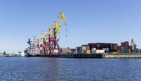 Cargo cranes in port royalty free stock photos