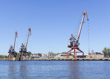 Cargo cranes in port stock photography