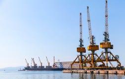Cargo cranes stand on the pier in Burgas. Harbor. Black Sea coast, Bulgaria stock images