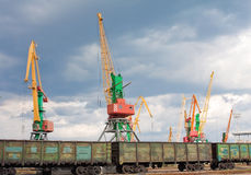 Cargo cranes and wagons in port Stock Image