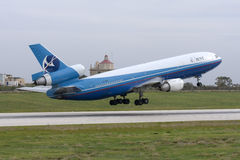 Cargo DC-10 lifting off the runway Stock Image