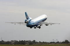 Cargo DC-10 lifting off the runway Stock Photography