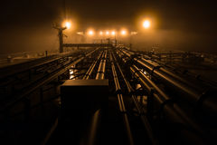 Cargo deck of tanker at night. Stock Photo
