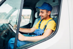 Cargo delivery, driver courier sitting in truck Stock Image