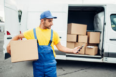 Cargo delivery service, courier with box and phone Stock Images