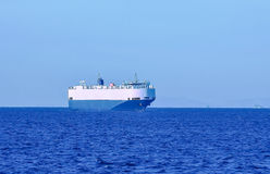 Commercial ship. Large cargo ferry in the blue sea Royalty Free Stock Photography