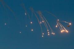 Cargo flypast with anti-missile defence bomb burst Stock Photo