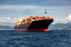 Cargo freight, container ship. In sea Stock Photo