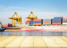 Cargo Ship Container. Cargo freight ship and cargo container working with crane at port for logistics and transportation background Royalty Free Stock Image