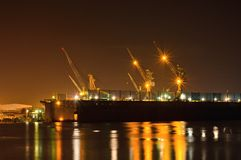 Cargo freight ship with crane in repair shipyard Royalty Free Stock Photography