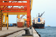 Cargo freight ship in harbour Royalty Free Stock Photos