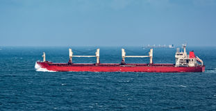 Cargo freight ship in stormy sea Royalty Free Stock Images