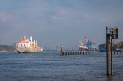 Cargo freighter YongXing arrives in Hamburg Harbor. stock images