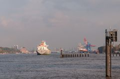 Cargo freighter YongXing arrives in Hamburg Harbor. royalty free stock photo