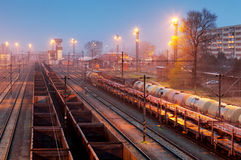 Cargo freigt train railroad station at dusk Royalty Free Stock Photo