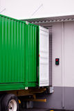 Cargo green container at dock warehouse under loading unloading Royalty Free Stock Photography