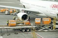 Cargo handling containers into an aircraft Stock Photos