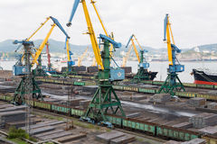 Cargo handling of metal on a ship in Nakhodka, Russia Royalty Free Stock Images