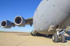 Cargo Jet. A military cargo jet sits on a tarmac Stock Photography