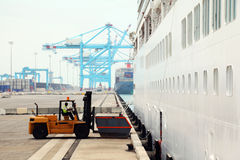 Cargo loading in dock, workers and loader Stock Photography