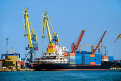 Cargo loading in the port. Cargo loading. Dry cargo ship in the port Stock Photography