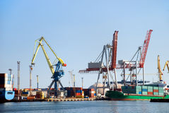 Cargo loading in port. View on the port with loading cargo ship Stock Photo