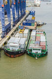 Cargo loading on transporter ship Stock Photo