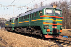 The cargo locomotive is going. The pair of cargo locomotiver 2M62 is going from Moscow Royalty Free Stock Photos