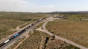 Cargo locomotive railroad engine crossing Arizona desert wilderness. USA