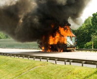 Cargo loss. In track engulfed by fire with black smoke Stock Photography